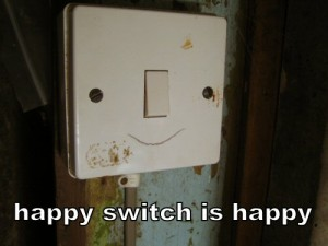 Light switch with crack in the shape of a smile